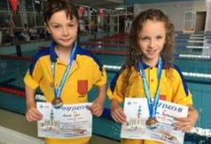 Jolanta Kwietniewska i Marcel Wilk z medalami (link otworzy duże zdjęcie)
