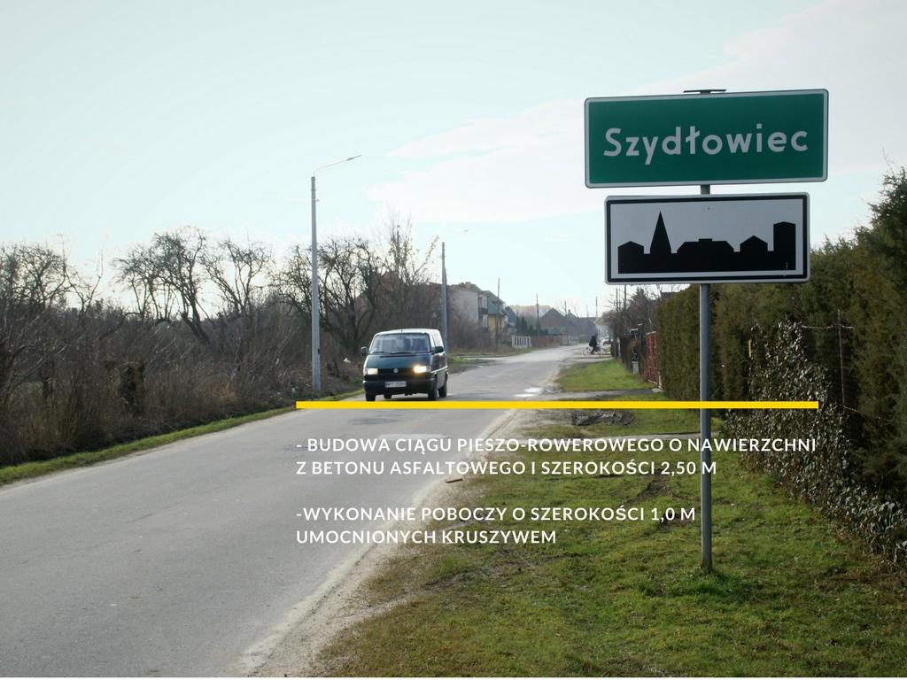 zdjęcie z napisem: - budowę ciągu pieszo-rowerowego o nawierzchni z betonu asfaltowego i szerokości 2,50 m  -wykonanie poboczy o szerokości 1,0 m umocnionych kruszywem