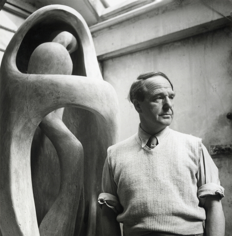 Henry Moore in his studio at Perry Green, with the elmwood Upright Internal/ External Form, c.1954.Photo