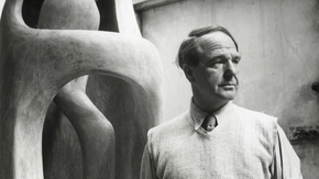 Henry Moore in his studio at Perry Green, with the elmwood Upright Internal/ External Form, c.1954.